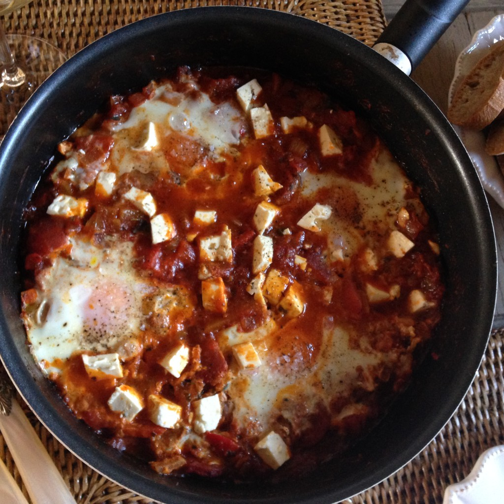 Shakshuka, a delicious Arabian inspired dish with tomato, eggs, lots of spices and herbs.