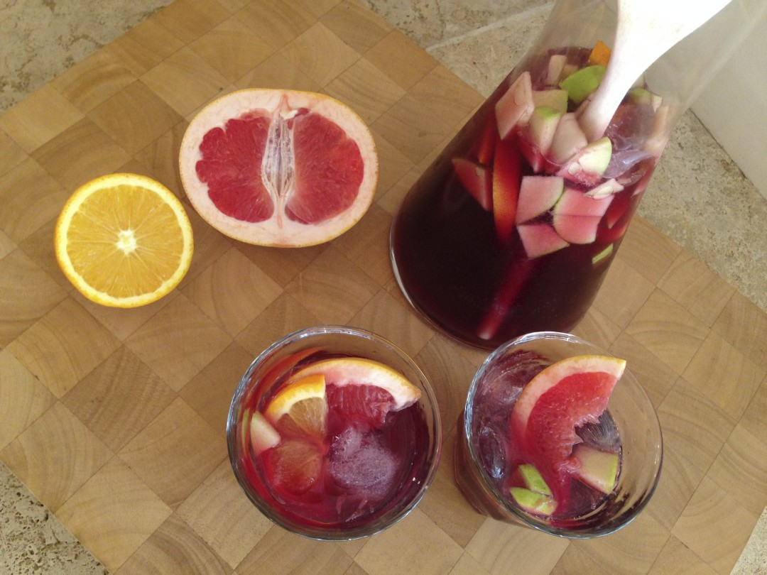 This Sangria is made with red wine, Limoncello, and fruit like grapefruit, oranges, apple, lemon, a hint of sugar and lots of love