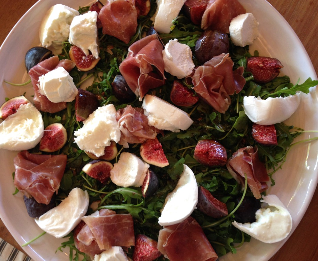 with mozzarella, goat's cheese, rucola and balsamic olive oil dressing