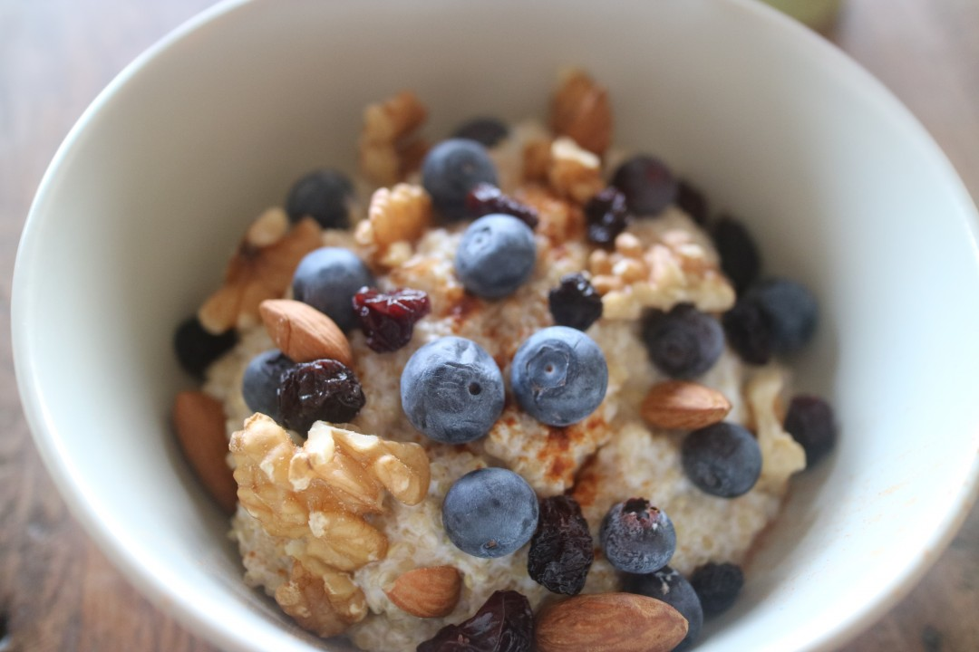 Quinoa breakfast with blueberries, almonds, walnuts, cinnamon and honey